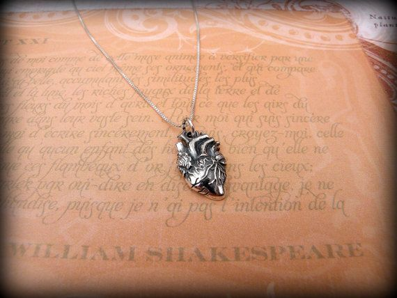 This is a sterling silver anatomical heart necklace that comes on a sterling silver chain.    This listing is for the heart charm and chain