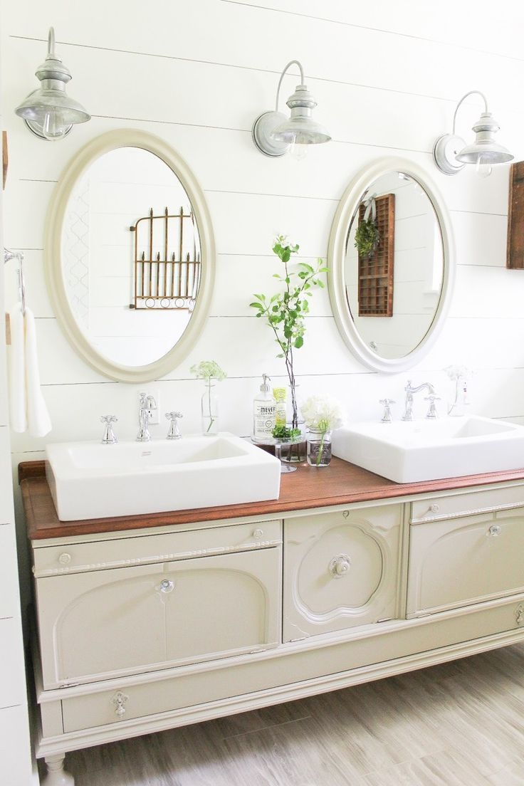 D. Lawless cut glass knobs are lucky to be featured on the drawers of this farmhouse bathroom makeover from Making it in the Mountains!