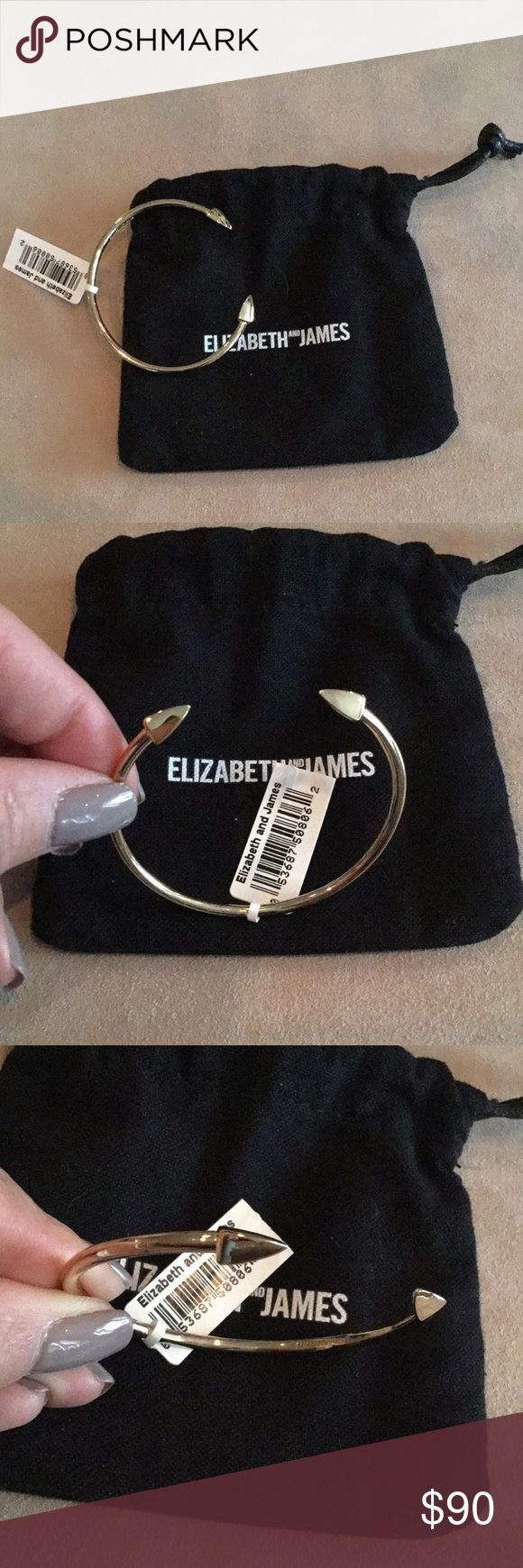 """Elizabeth and James Signature Vogel Cuff Sharpen your collection of cool-girl extras with Elizabeth and James' arrow-tipped cuff. 2.25"""" diameter No closure 22k gold–plated.  NEW WITH TAG Elizabeth and James Jewelry Bracelets"""