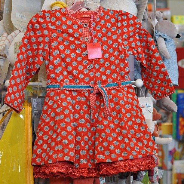 This dress was made for twirling! Bold print belted waist button closure ADORABLE thin-waled corduroy Oilily dress with double-layer skirt and contrasting ruffle trim. $120 || The Children's Hour Bookstore & Boutique || Clothing  Gifts  Toys  Shoes || 898 South 900 East || Salt Lake City Utah || 801.359.4150 || childrenshourbookstore.com