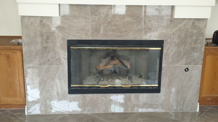 Custom Fireplace Installed By Affordable Flooring More Using 20x20 High Gloss Tile Color