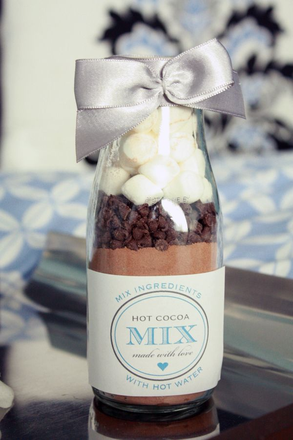 DIY: just fill a glass bottle with chocolate powder, chocolate drops and marshmallows. Decorate with a printed label and ribbon.