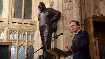 David Cameron at the statue of Winston Churchill