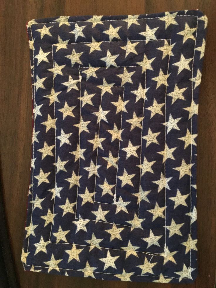 Mug Rug made of antique looking blue star material.