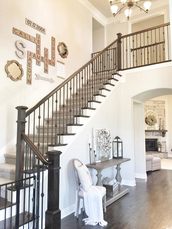 33 Stairway Gallery Wall Ideas To Get You Inspired: Love This Staircase. The Dark Stained Staircase Bannister