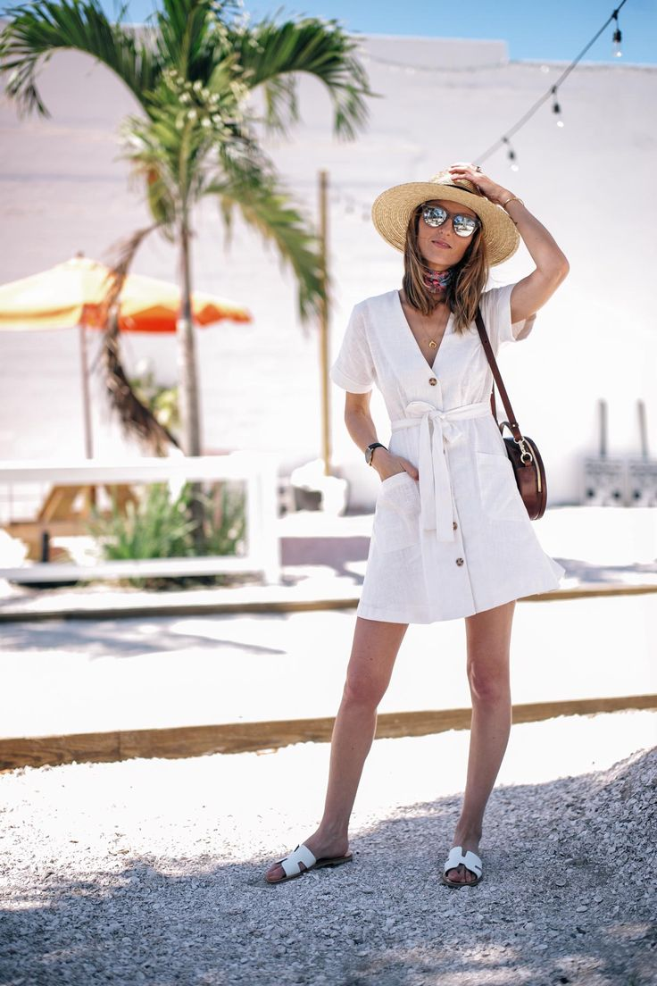 Jess Ann Kirby enjoys the sun in Florida in a Moon River white linen dress