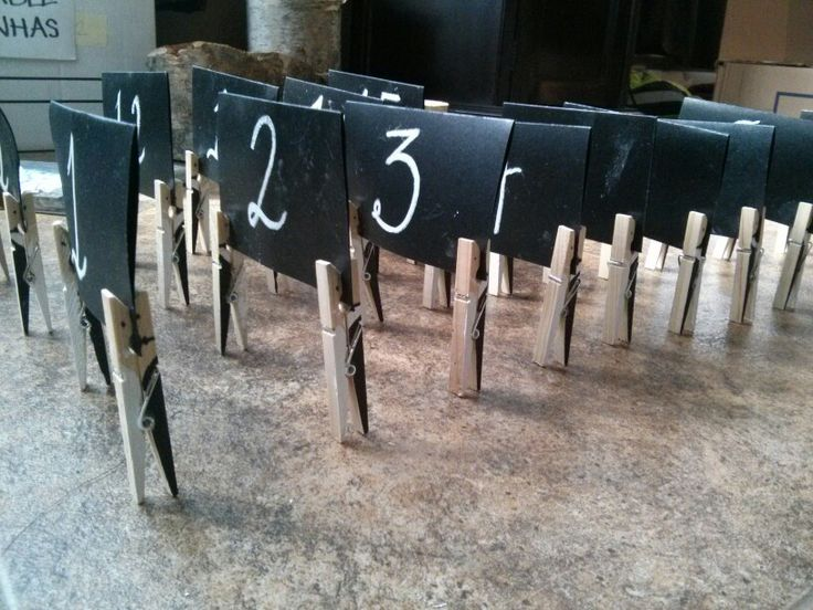 Table numbers + bride and groom pegs
