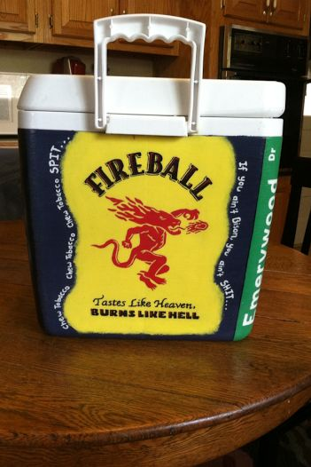 This is a cooler that i painted for a group of my friends. One of our favorite drinks is Fireball, so i did the Fireball label and around the edges i wrote out one of our school's student section chants.