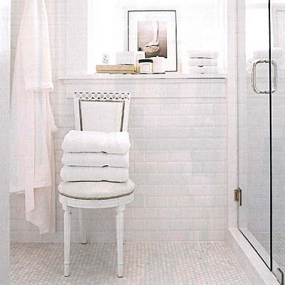 lovely bathroom. chair for the towels adds a nice touch.