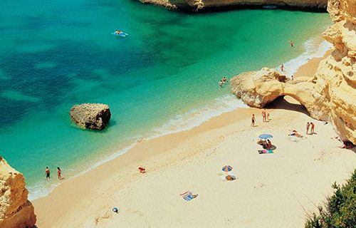 Where to go on holiday in August   Praia da Marinha beach, Algarve   http://www.weather2travel.com/holidays/where-to-go-on-holiday-in-august-for-the-best-hot-and-sunny-weather.php #travel #holidays