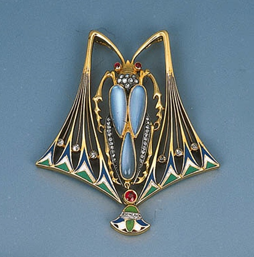 An Art Nouveau Gem-set and Enamel Beetle Pendant   The body of drop-shaped moonstones with rose-cut diamond legs and ruby eyes, circa 1902