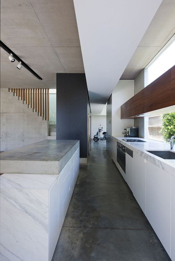 Fluid-Rooms.  Minimalist kitchen - concrete floor with contrasting white and timber joinery