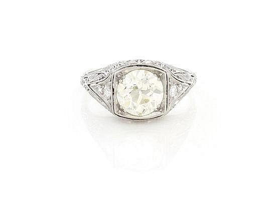 Art Deco platinum filigree diamond engagement ring by Charlton Hall Estimat