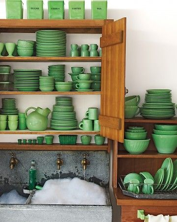 Martha Stewart's Jadeite Collection - green dishes in a wooden cabinet. favsthecolorgreen