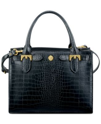 Elegant hardware lends a refined look to a sturdy and sophisticated tote from…
