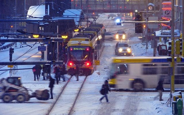 minneapolis: hiawatha light rail line and metro transit bus on nicollet mall