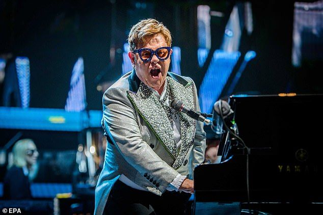 Elton John 72 Looks Typically Dazzling In A Crystal Embellished Suit Elton John Blue Suit Jacket Powder Blue