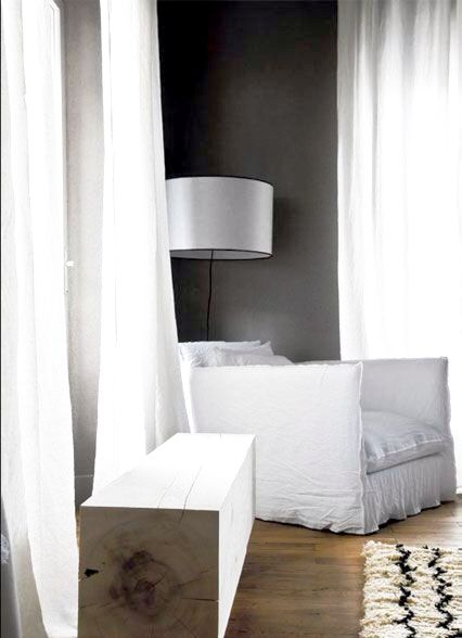 Paris interior with dark walls and white curtains