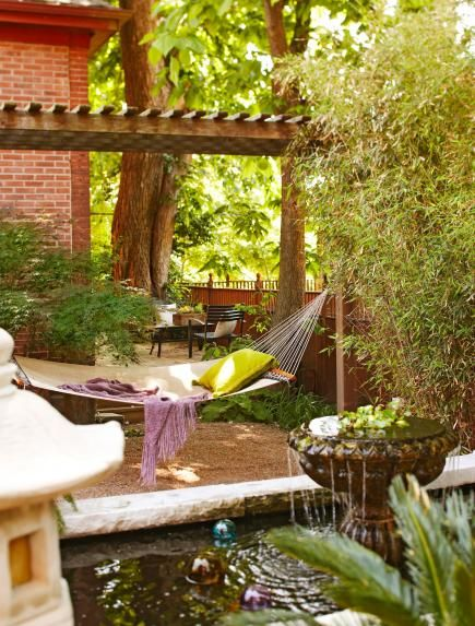 Bamboo, a hammock and a koi pond offer a bit of the tropics—and an appealing place to relax—in this Kansas City yard. More beautiful backyards: http://www.midwestliving.com/garden/ideas/30-beautiful-backyards/