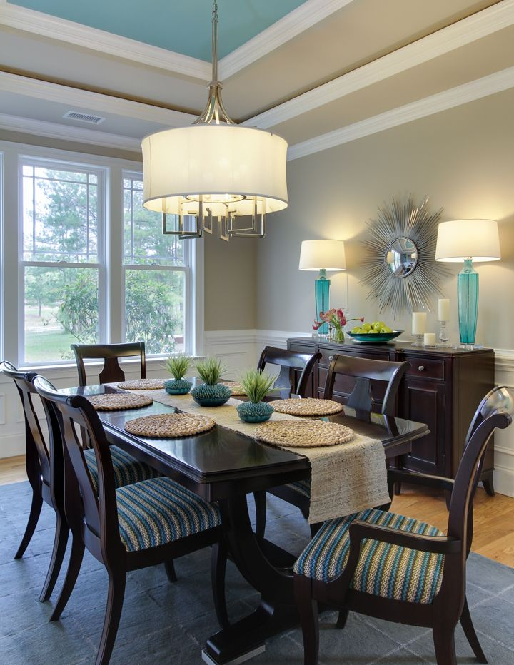 dining room with turquoise accents and ceiling
