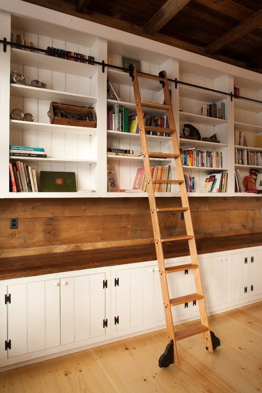 Love it! Buy bookcases from Ikea and add the bar for the ladder and wheels to the ladder! When i get my own place i am sooooo doing this!