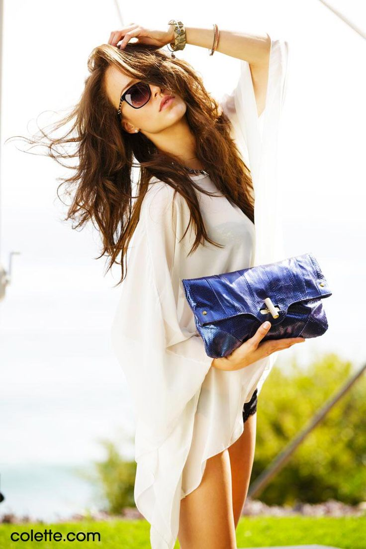 Malena Morgan for http://colette.com stunning with the blue, metallic python clutch and #Chanel #sunglasses!