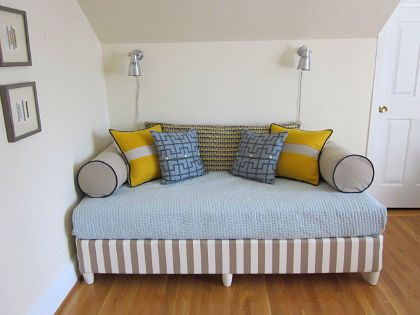 "Upstairs TV Room?    DIY day bed - Cover the box spring in fabric & add furniture legs.  Such an inexpensive way to ""furnish"" a room nicely.  (No way those bolsters aren't rolling right off, though.)"