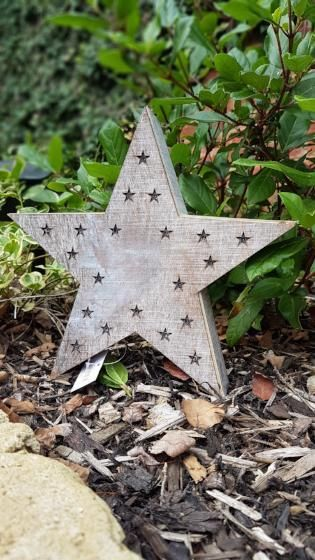 This wooden box star is free standing or can be hung on a wall.    Featuring 20 battery powered LED lights set in tiny cut out stars.  This is a pretty decorative piece with a whitewash effect which will look fabulous in any room and makes a lovely gift. #stars #starlight #led #homedecor #christmas #christmaslights