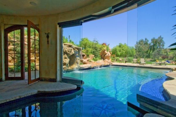 Striking Idea of Swimming Pool that Lays Indoor and Outdoor