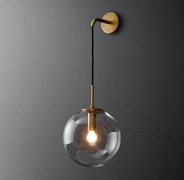 Would LOVE to see our Plumen and WattNott bulbs in this! - www.plumen.com RH Modern's Languedoc Sconce:The character of 1960s French lighting is captured in this sconce from renowned designer Jonathan Browning. With glass globes suspended from a slender brass frame, the fixture has the appearance of magically floating in space.