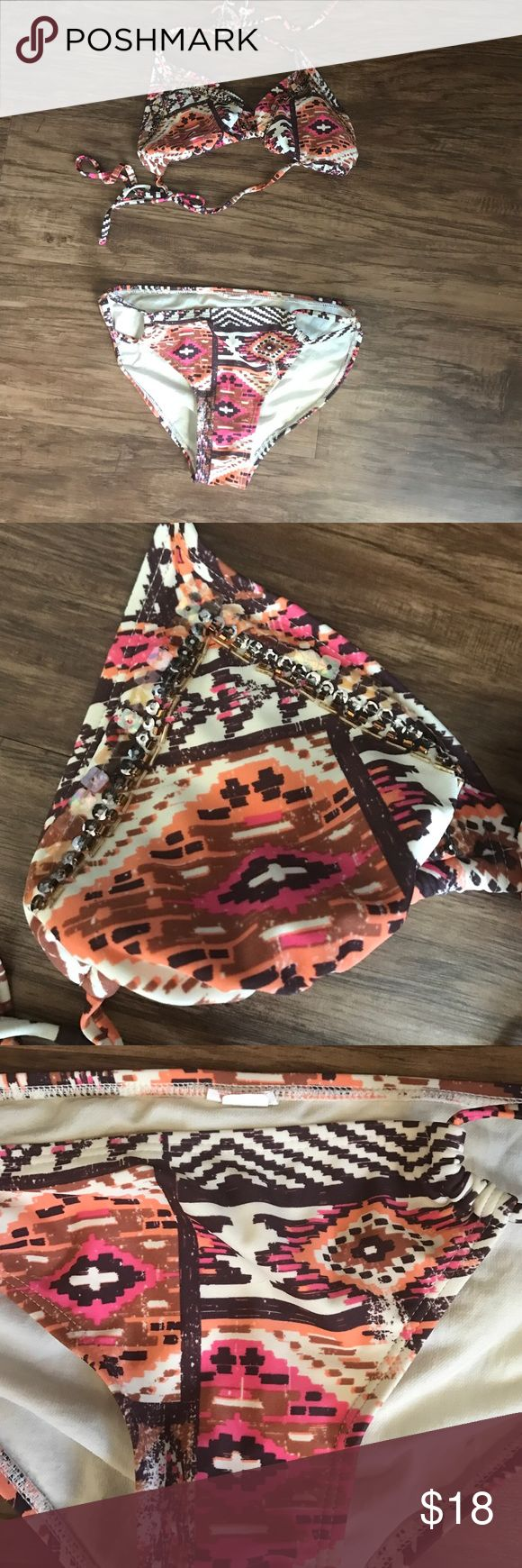 Tribal/Aztec print bikini Great condition!! Worn a few times but no stains, holes, or imperfections. Size XS top and bottom, although the tag is cut out of the bottom because it would stick out. Top is padded, full coverage bottoms. Xhilaration Swim Bikinis