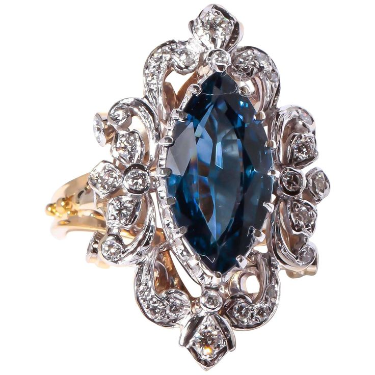 Sapphire Diamond Gold Ring. This Victorian reproduction in18K white and yellow gold is, set with one 4.80 ct Marquise cut Sapphire and .60 ct. total weight in diamonds.