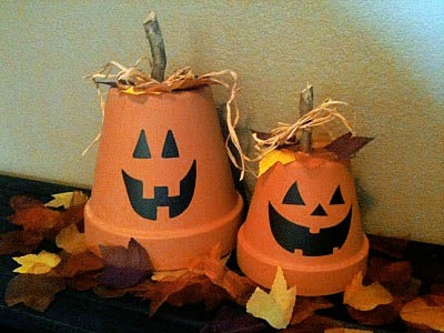 Adorable flower pot pumpkins!