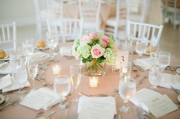 simple, short table center pieces in neutrals.