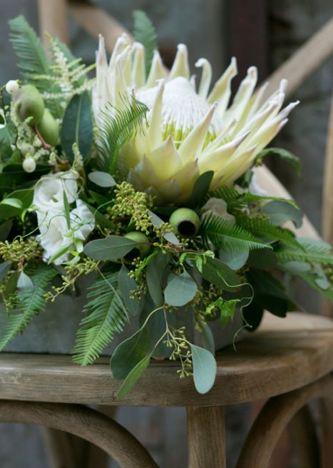 King protea, eucalyptus, ferns  |  Wedding at The Wythe in Williamsburg  |  Floral Design by Tinsel & Twine  |  Photography by Kate Neal Photo