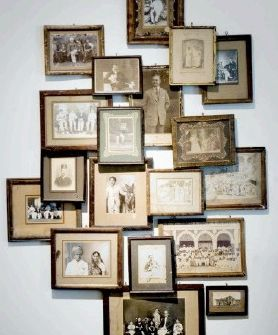 Very interesting way to hang old photos--collage style with frames--found on Dianne Hudson's blog.