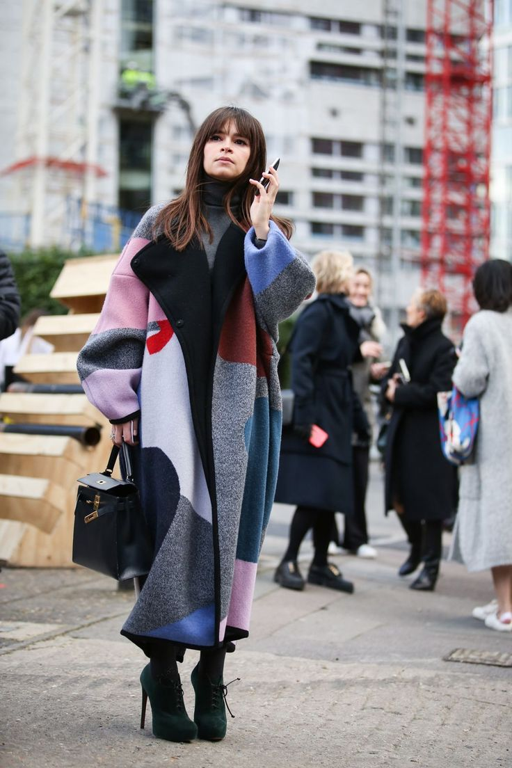Oversize that jacket (and that jacket's print), and you can wear all the basics you want underneath. #refinery29 http://www.refinery29.com/2015/02/82710/london-fashion-week-2015-street-style#slide-69