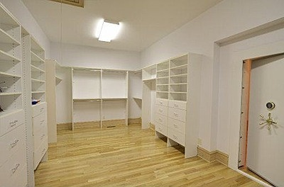 Master walk in closet with safe room gun safe for Walk in gun vault room