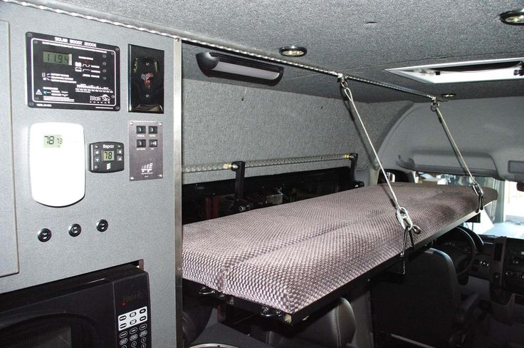 Fold down bed in a Sprinter.                                                                                                                                                     More
