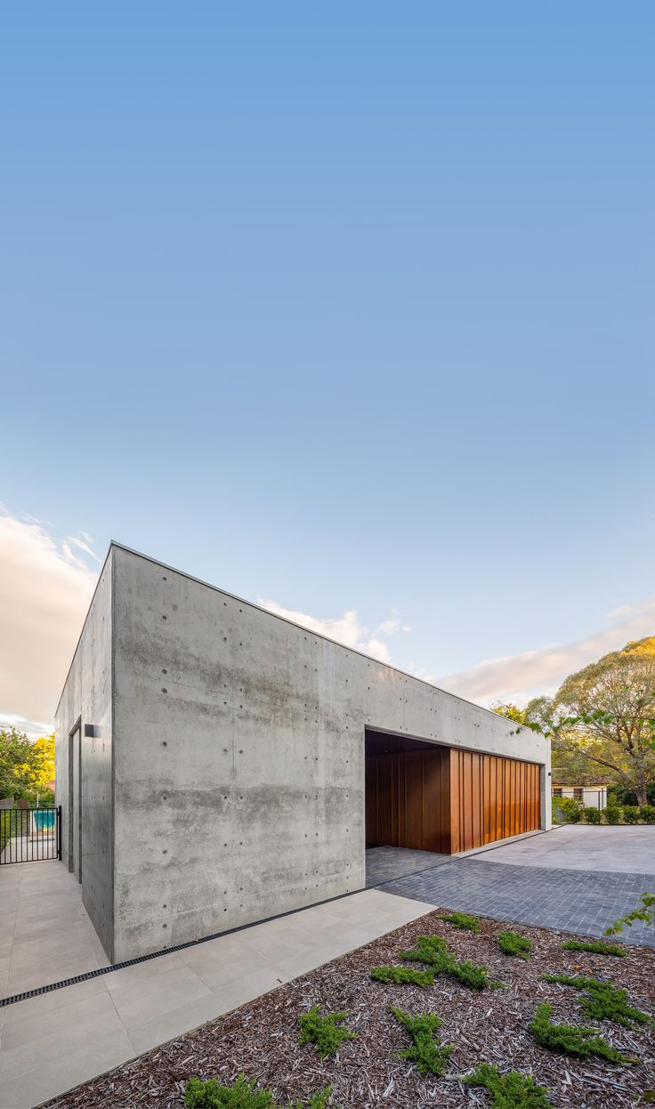 Modern architecture, off-form concrete, corten steel.  By Collins Caddaye Architects, Canberra.  Photographed by Stefan Postles, Chalk Studio.
