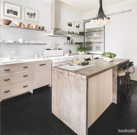Located in San Francisco, this Victorian home has plenty of charm. An island made of weathered barnwood, with a built-in Carrara marble cutting board, adds warmth and texture. Click through for more kitchen countertop design ideas.
