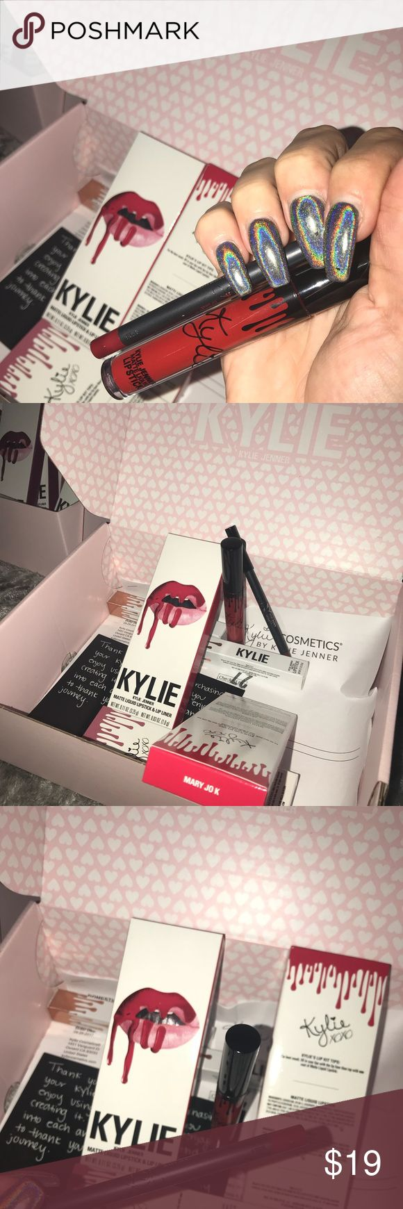 "Kylie Jenner ""MARY JO K"" Lip Kit Authentic and brand new in original packaging.                      Mary Jo K is a true blue red.  Each Lip Kit contains:   1 Matte Liquid Lipstick (0.11 fl oz./oz. liq / 3.25 ml) 1 Pencil Lip Liner (net wt./ poids net  .03 oz/ 1.0g) Kylie Cosmetics Makeup Lipstick"