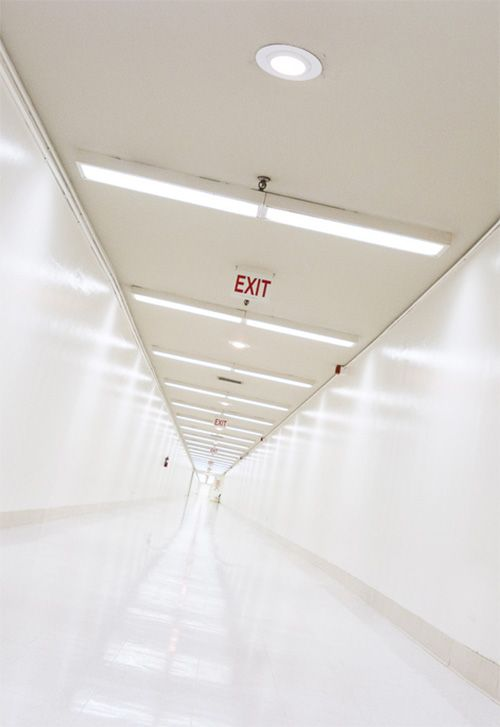 At the Facility, the inner part where the kids live is surrounded by observation passages that are closed off from the rest of the outer Facility. The exit signs may or may not lead to actual exits from the building.<<pp