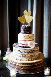 Momofoku layered wedding cake with gold heart cake toppers