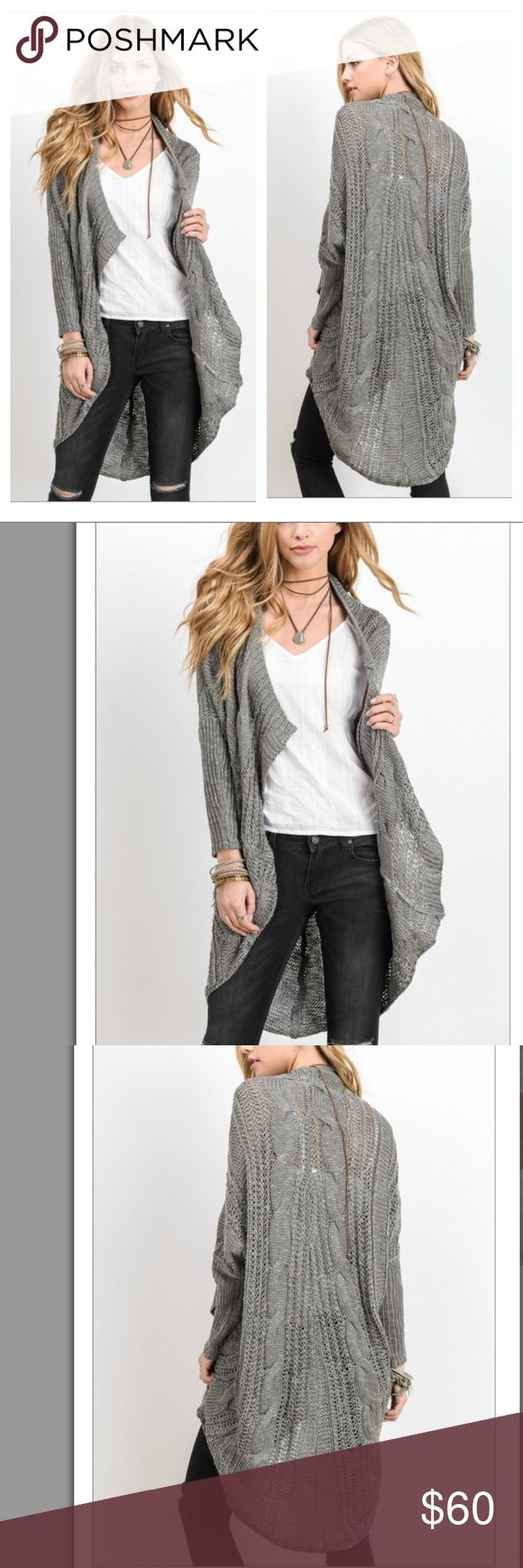"""LAST 1 🆕Grey Cable Knit Cardigan ✨Have I mentioned how much I LOVE 😍 fall. This loose cable knit cardigan... Ready to ship NOW in grey (taking pre-orders for pink & black coming in August) is going to be the perfect transitional piece to take you from these warmer days to the cool weather in fall!   Note: 💕 S/M about 28"""" Pit to Pit 41"""" length   Material - Polyester & Acrylic Desired Collection Sweaters Cardigans"""