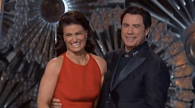 """A year after John Travolta's bizarre mispronunciation of Idina Menzel's name at the 2014 Oscars — and a year after the birth of the Adele Dazeem meme — the two wickedly talented friends reunited on the 2015 Oscars stage. 