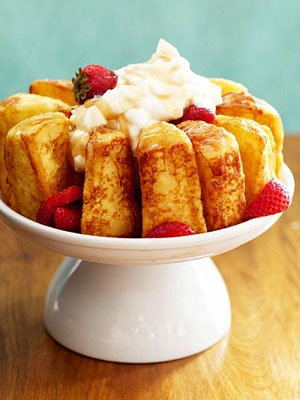 French-toasted angel food cake with strawberries, cream and maple syrup. Wow!