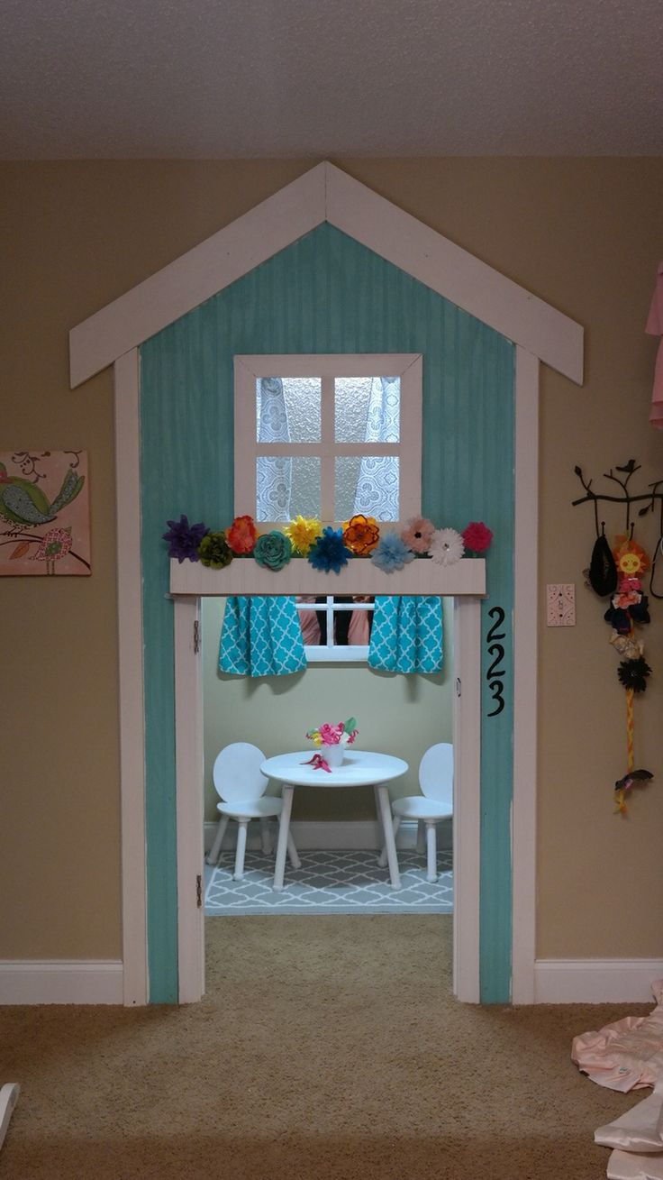 My daddy custom built this playhouse frame for my little girl. We transformed her walk in closet into an indoor playhouse.