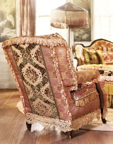 """Vintage-fabric-chair-HTOURS0505    Cows had chewed on the chair that Robin found at a local barn sale. Elaborately transformed with vintage fabrics, trims of old lace, and looped ribbon, its style is pure """"Magnolia Pearl,"""" the name of Robin's homegrown business in Bandera, Tex."""