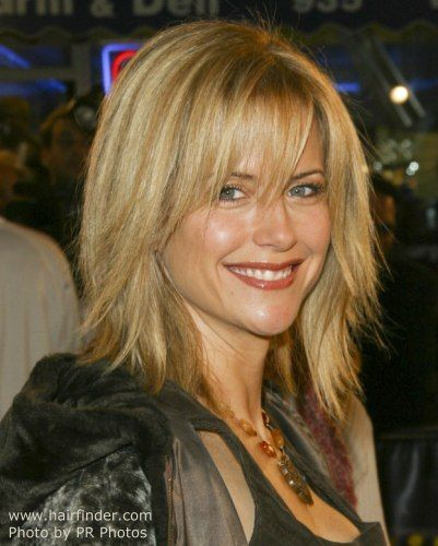 Kelly Preston with razor cut hair